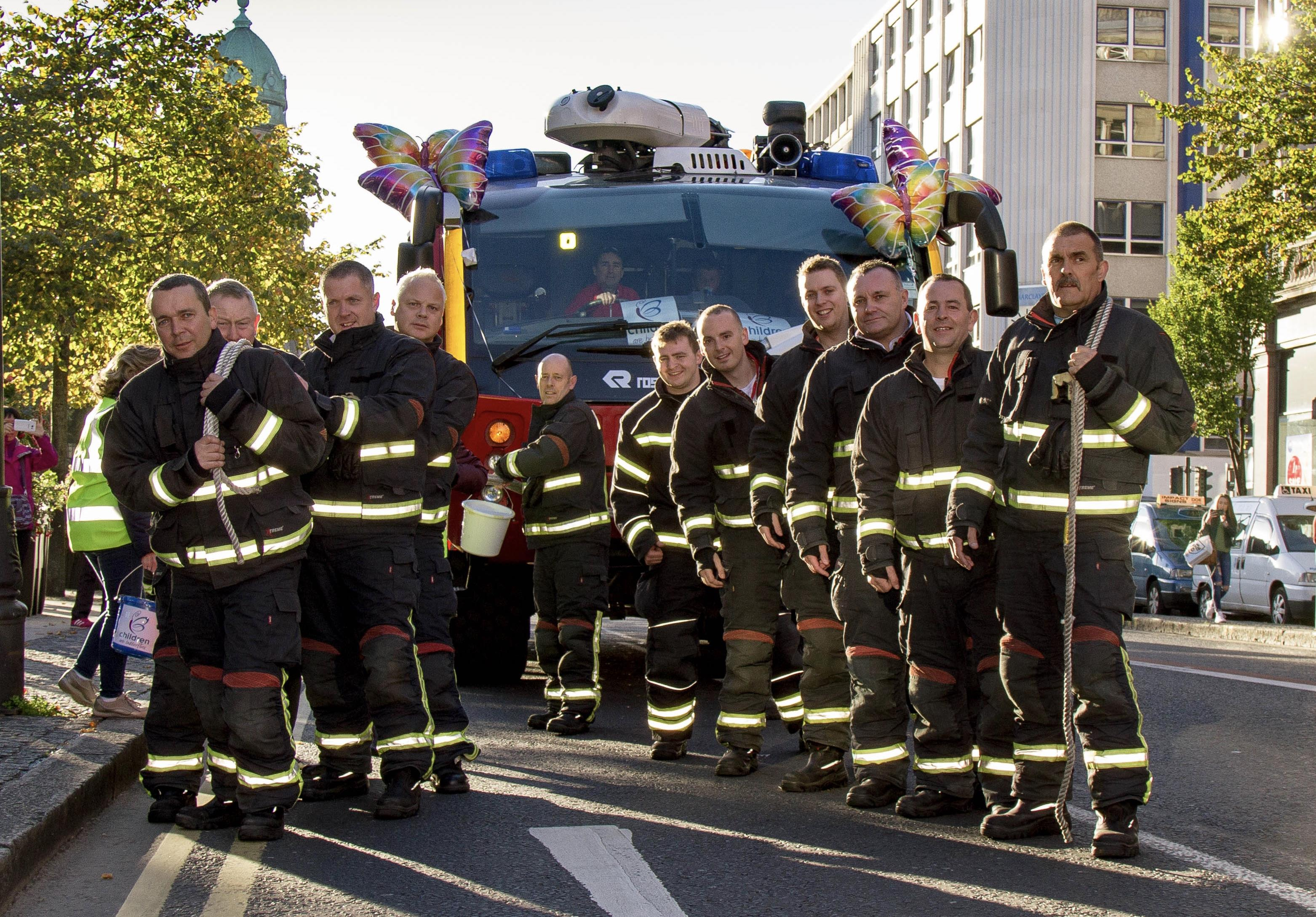 Belfast International Firefighters prove their 'pulling power' raising £4,500 for charity